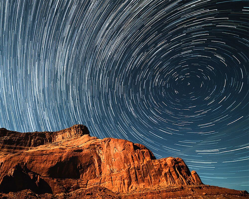 amazing sky star trail over red rock mountain