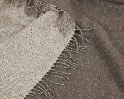 50% merino wool, 50% linen. Made in Lithuania. Informally elegant and fully reversible, versatile Blix Throw